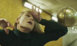 Rosamund Pike Channels Isabelle Adjani For Massive Attack & Young Fathers
