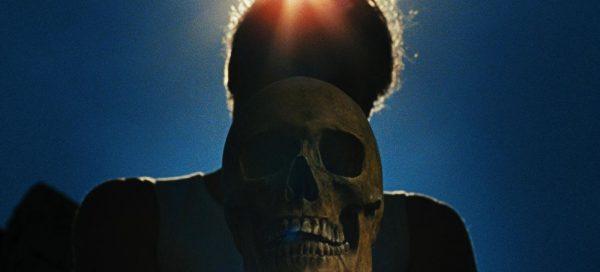 Let the Corpses Tan review Helene Cattet Bruno Forzani skull